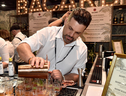 Bartender pouring cocktails at the Bacardi booth