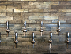 Silver taps on modern bar wall