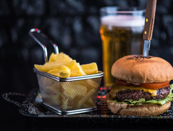 Burger with knife, French fries and beer