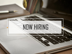 NOW HIRING text over notebook and laptop