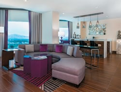 Harrah's Las Vegas' Vice Presidential Suite has a living room and dining room along with a bedroom complete with a king-sized bed.