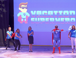 General Manager of Network Engagement and Performance Drew Daly as the Vacation Superhero with members of the marketing team.