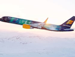 Icelandair airplane flying over snow