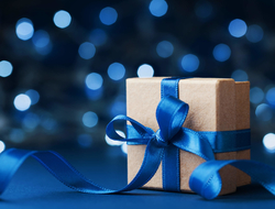 Gift box wrapped with blue ribbon