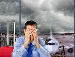 Businessman crying in airport with stormy weather in the background