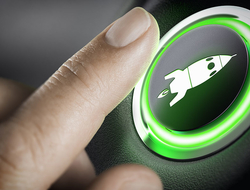 Man finger pressing an boost button with a rocket icon, black background and green light