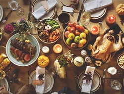 Top down view of a Thanksgiving dinner on a table