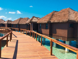 The over-the-water villas at Sandals Royal Caribbean, Montego Bay are connected to the resort's private island by bridge.