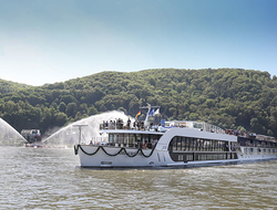 Water cannons celebrate the arrival of the AmaKristina to its christening ceremony