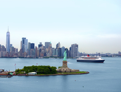 Queen Mary 2 sails with New York City skyline in background