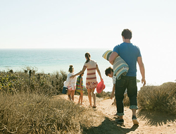 Family walking to the beach