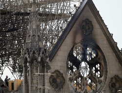 A worker checks on a wooden support structure placed on the Notre Dame Cathedral in Paris.