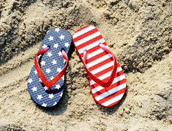 American flag sandals on a beach