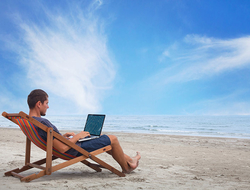 businessman working with computer on the beach