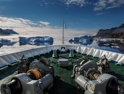 Image of a ship traversing the arctic