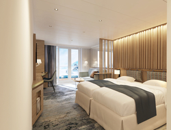 Image of the bedroom with white beds