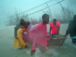 Volunteers rescue several families from the rising waters of Hurricane Dorian, near the Causarina bridge in Freeport, Grand Bahama.