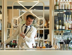 a man mixing drinks at a bar