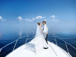 Happy bride and groom on a yacht
