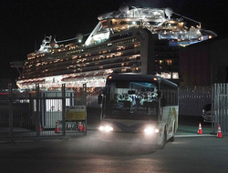 Buses carrying Australian passengers from the quarantined Diamond Princess cruise ship leave a port in Yokohama, near Tokyo.