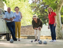 Group of people playing bocce