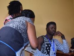 Volunteer Idrissa Kamara receives the first dose of Janssen's prime-boost vaccine regimen at a health clinic in Sierra Leone
