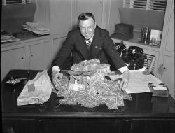 Man with pile of money