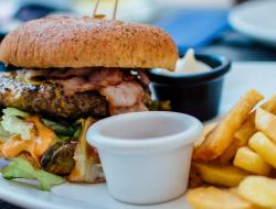A cheese burger and french fries on a plate