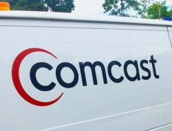 """Utility van with the word """"Comcast on the side"""""""