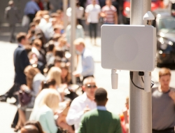 small cell technology on a pole on a sidewalk