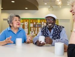 Oak Street patients sit at table