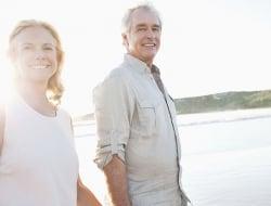 Older couple walking on a beach