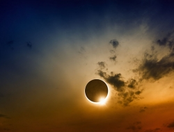 Total solar eclipse with clouds