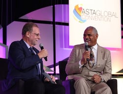 Peter Greenberg, travel reporter for CBS, and Arnold Donald, CEO of Carnival Corporation, onstage at the ASTA Global Convention