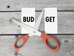 "scissors cutting the word ""budget"" in half"