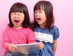 Little girl terrified by content shown on tablet (source: iStock)