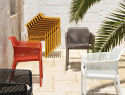The collection includes chairs intended for outdoor usage, whether it be on a deck or poolside.