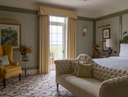 Martin Brudnizki's redesign of Four Seasons Hotel Hampshire's Royal Suite inspired by English manor house interiors.