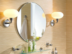 GINGER, the sister brand of Newport Brass, introduced sconces in each of its accessory collections that illuminate the bathroom mirror.