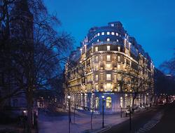 Corinthia Hotel London facade at night