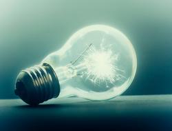 Light bulb on dark background