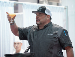 2018 NCB Show Chef Brian Duffy holding cocktail