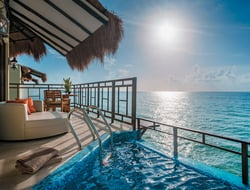 The Palafitos at El Dorado Maroma are over-the-water bungalows that come with a verandah, a private infinity pool and lounges.