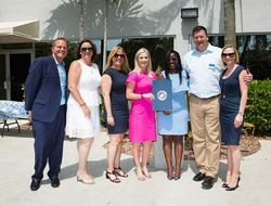 Drew Daly, general manager; Debbie Fiorino, senior vice president; Sandi Szalay, vice president of IT; Melissa Coningsby from City of Fort Lauderdale; Joelle Delva, vice president of operations; Dustin Jones, vice president of engagement; and Rosemarie Re