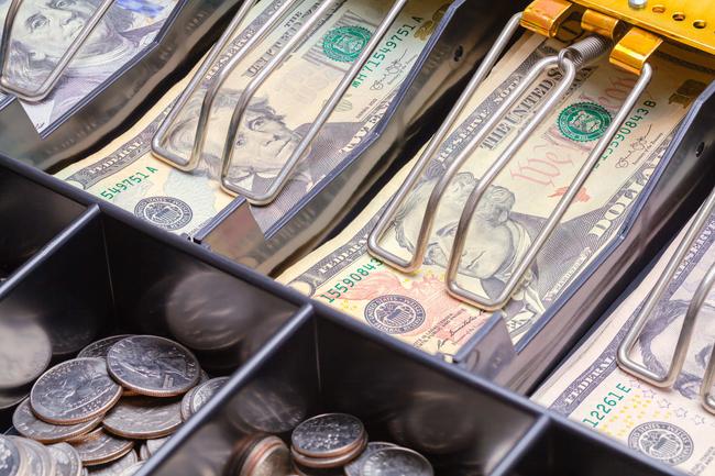 Cash register full of money