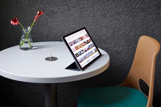 The new Legrand round furniture power center with USB-C offers power in a small, circular unit that is easily installed flush with any furniture piece.