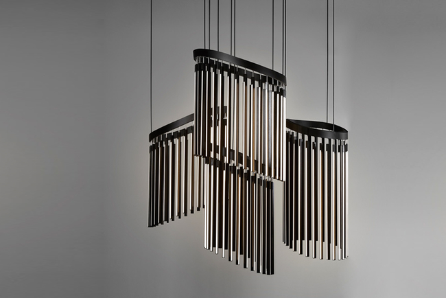 Chime, a playful reinterpretation of a classic chandelier, is a 10-foot-tall cascading arrangement made out of reclaimed redwood.