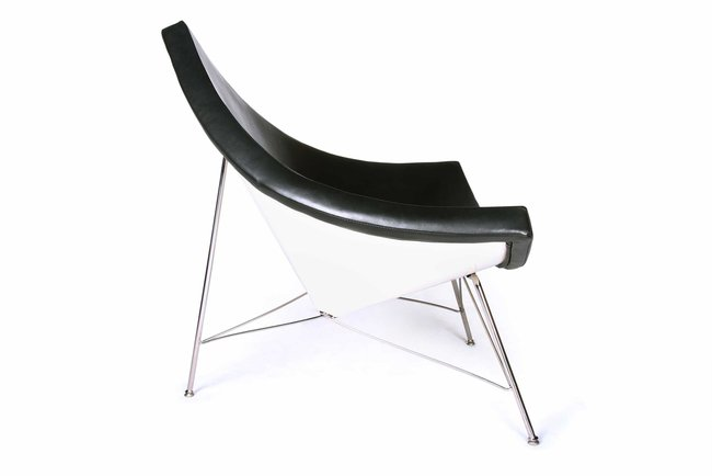 Designed by George Nelson, the chair resembles a fragment of a coconut shell. With an open frame, the chair has a fiberglass shell and stainless steel legs.
