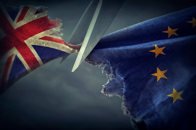 British flag being cut by scissors from the European union flag