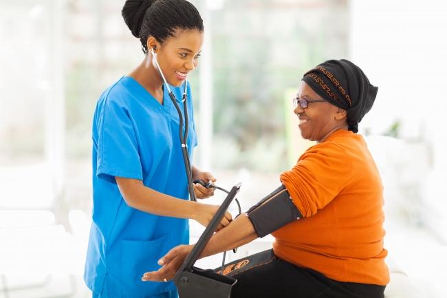 Doctor taking patient's blood pressure